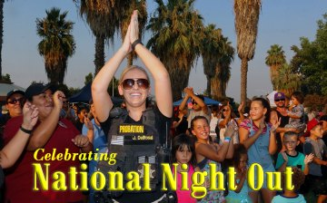 Local law enforcement officials joined with local residents and children to celebrate the 35th annual Neighborhood Watch program at Lemoore's Heritage Park Tuesday night.