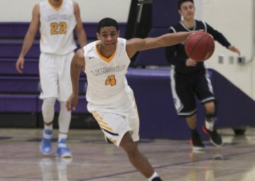 Lemoore's Allen Perryman helped Lemoore to an exciting win over Redwood Wednesday night in the Lemoore Event Center.