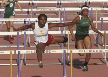 Kings Christian High's Moesha Davidson won the 100-meter hurdles at the Kiwanis Track Invitational Friday night.