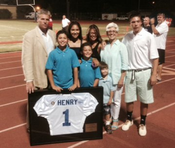 Longtime All Star Football chairman Bill Henry's family accepts jersey honoring him for his service.
