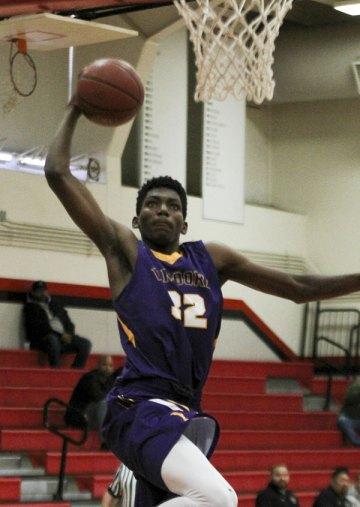 Jaylunn English looks for a dunk against Kennedy High
