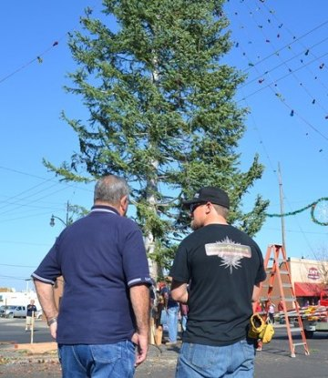 A pair of Lemoore Volunteer firemen admire the department's work.