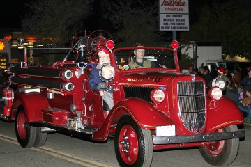 Lemoore's vintage fire truck in last year's Christmas Parade. The Volunteer Fire Dept. recently earned a high ISO rating making it one of the best departments in the country.