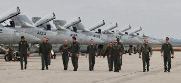Aviators with VFA 25 (Fist of the Fleet) arrive home Saturday afternoon following a record-setting 10-month deployment.