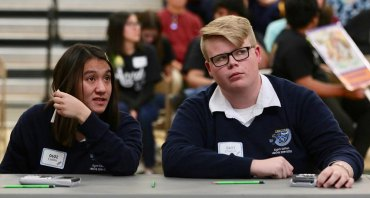 Lemoore Middle College High School students Caitlin Endo and Clayton Lahodny confer during Super Quiz at Saturday's Kings County Academic Decathlon.