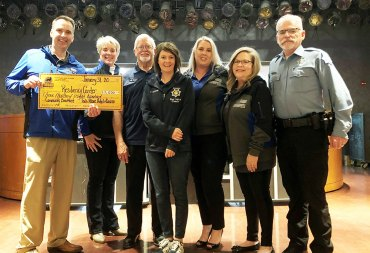 Fresno Police Chaplaincy Resiliency Center members accept monthly breakfast donation check from Palace Hotel and Casino.
