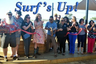 Surf Ranch Manager Sam Ramirez gets the royal welcome from Lemoore Chamber of Commerce officials and local dignitaries Tuesday at the local man-made surfing facility.