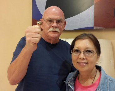 Don and Faye Ely with Jawanza William's 1991 class ring, lost for 20 years and recently returned.