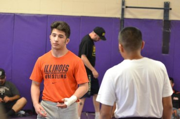 Isaiah Martinez at a Lemoore High School wrestling event a couple of years ago where he conducted a clinic for the Tiger wrestling program.