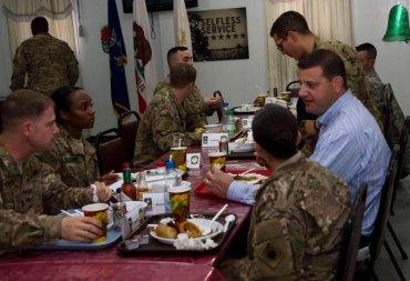U.S. Representative David V aladao having Christmas dinner with U.S. troops.