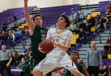 Lemoore's Derek Westendorff has his sights on the basket in Thursday's loss to El Diamante.