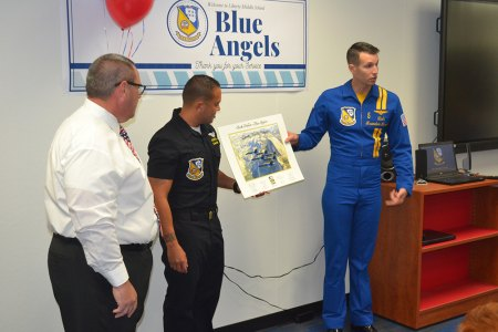 Lt. Cmdr. Brandon Hempler and Crew Chief Jeramie Race present to Liberty Principal Ben Luis a picture of the Blue Angels flying over Yosemite National Park.