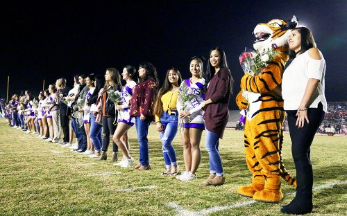 Friday night in Tiger Stadium was also Senior Night, a time to honor seniors during their final year. Before the game, the LHS Pep Squad seniors were introduced with their parents.