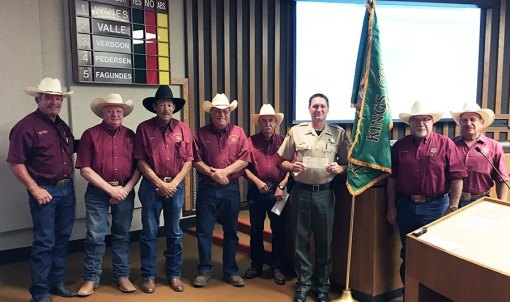 Posse members with Sheriff Robinson, left to right: John Henry Oliveira, Roland Stack, Jerry Jones, Roger Hewitt, Larry Wilkinson, Sheriff Robinson, Anthony Azevedo, John Fagundes.