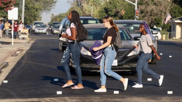 Students, despite street construction, make their way to Lemoore High School for the first day of School Wednesday.