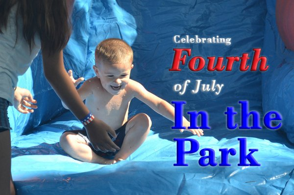 Jace Barefield, just three years old, enjoys one of the many water slides at the City of Lemoore's July Fourth Celebration on Wednesday.