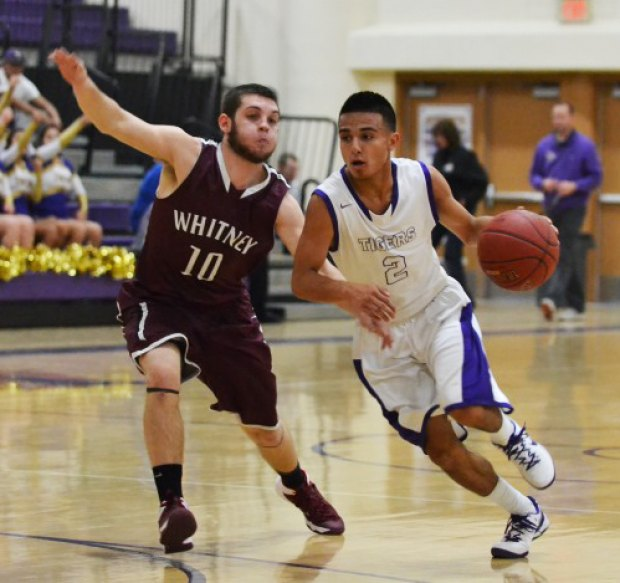 Erick Perry in an earlier game versus Mt. Whitney. He had a pair of three pointers in the final minutes to lead Lemoore.
