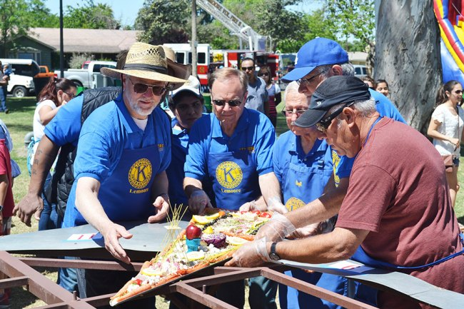 The Lemoore Kiwanis Club create a pizza during last year's Central Valley Pizza Festival.